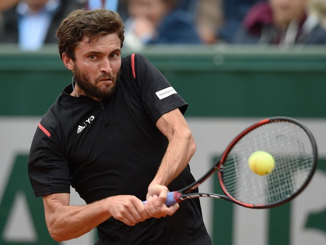 Gilles Simon returns the ball to Rogerio Dutra Silva at the French Open in Paris on May 23, 2016