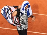 Jo-Wilfried Tsonga walks off the court after retiring during the French Open on May 28, 2016