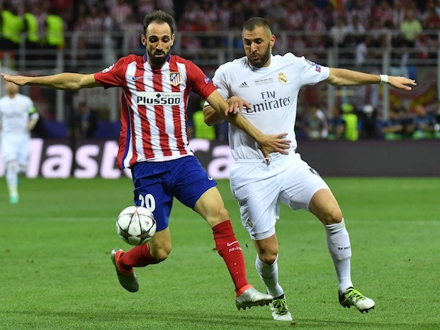 Juanfran and Karim Benzema in action during the Champions League final between Real Madrid and Atletico Madrid on May 28, 2016