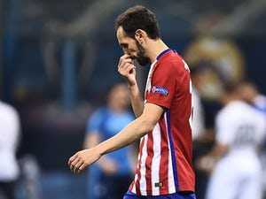 Juanfran reacts to his penalty miss during the Champions League final between Real Madrid and Atletico Madrid on May 28, 2016