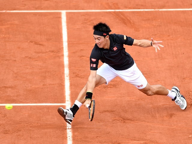 Kei Nishikori plays a backhand against Andrey Kuznetsov at Roland Garros on May 25, 2016