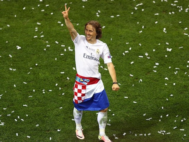 Luka Modric celebrates after the Champions League final between Real Madrid and Atletico Madrid on May 28, 2016