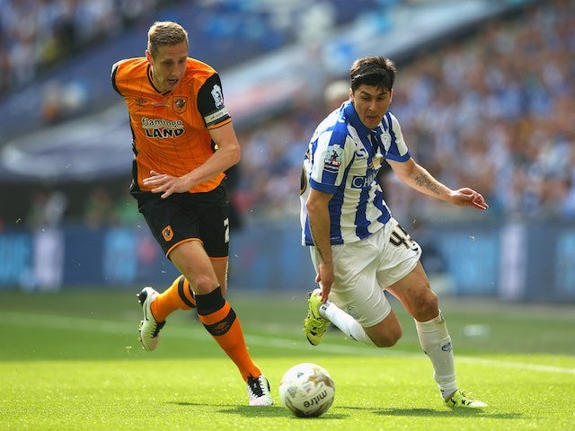 Michael Dawson and Fernando Forestieri in action during the Championship playoff final between Hull City and Sheffield Wednesday on May 28, 2016