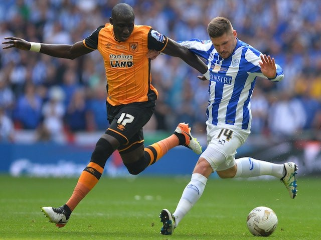 Mohamed Diame and Gary Hooper in action during the Championship playoff final between Hull City and Sheffield Wednesday on May 28, 2016