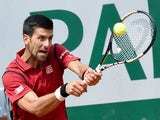 Novak Djokovic returns the ball to Steve Darcis at the French Open in Paris on May 26, 2016