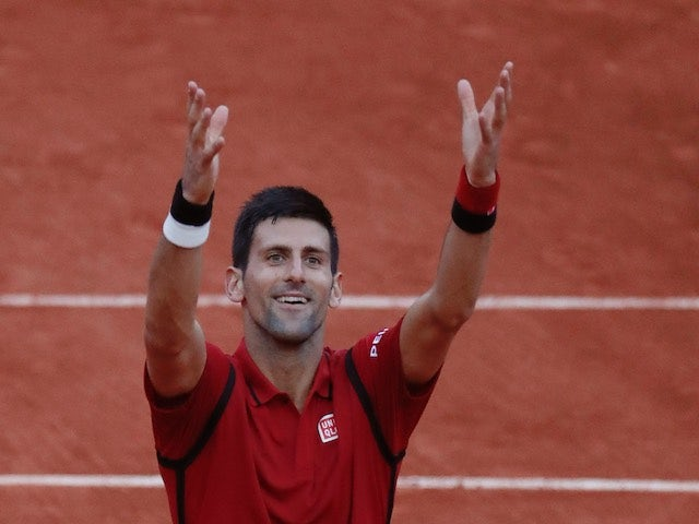Novak Djokovic celebrates advancing to the fourth round of the French Open on May 28, 2016