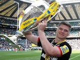Owen Farrell majestically hoists the trophy aloft after the Aviva Premiership final between Saracens and Exeter Chiefs on May 28, 2016