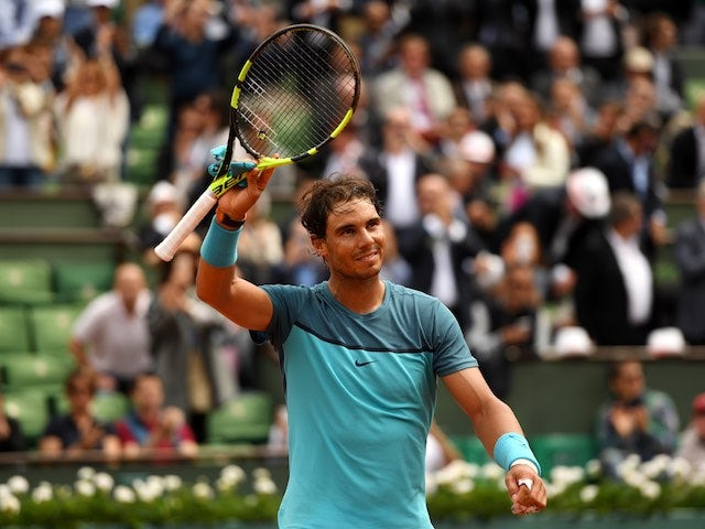 Rafael Nadal celebrates victory in round two of the French Open on May 26, 2016