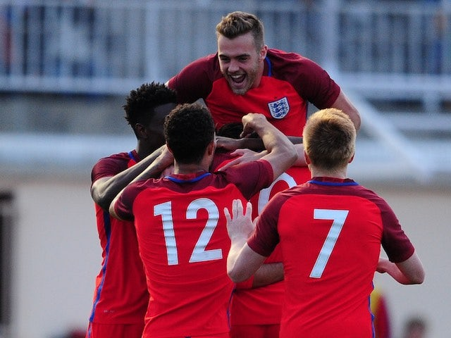 Calum Chambers jumps on top as Ruben Loftus-Cheek celebrates his second goal with teammates during the game between Paraguay under-23s and England under-21s on May 25, 2016