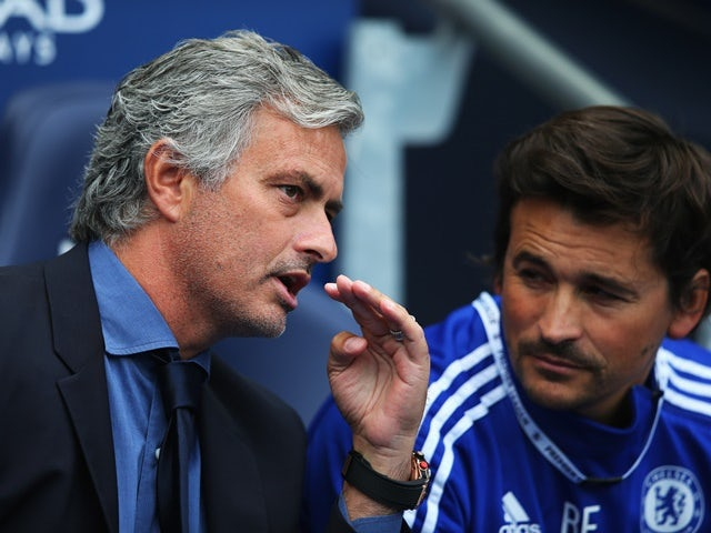 Jose Mourinho talks to Rui Faria during the Premier League match between Manchester City and Chelsea at the Etihad Stadium on August 16, 2015
