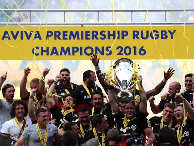 Saracens players celebrate with the trophy after the Aviva Premiership final between Saracens and Exeter Chiefs on May 28, 2016