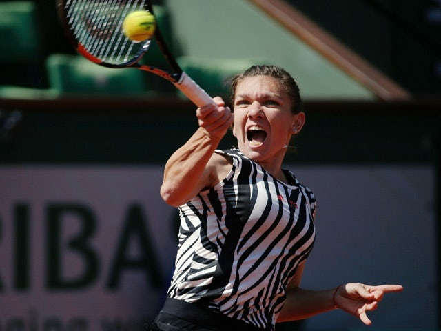 Simona Halep returns the ball to Zarina Diyas during their women's second-round match at the French Open on May 25, 2016