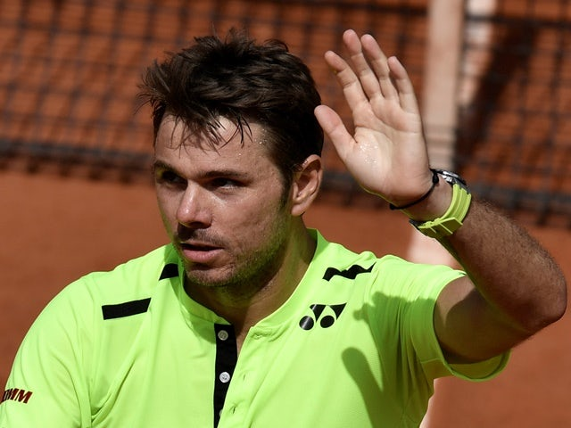 Stanislas Wawrinka celebrates after winning his second-round match against Taro Daniel at the French Open in Paris on May 25, 2016