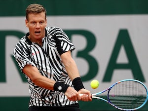 Berdych safely through to round three