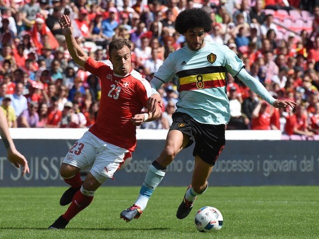 Xherdan Shaqiri and Marouane Fellaini in action during the international friendly between Switzerland and Belgium on May 28, 2016