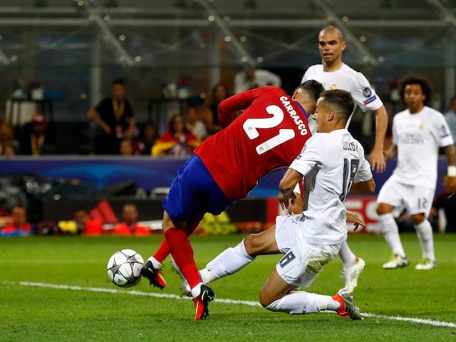 Yannick Carrasco scores the equaliser during the Champions League final between Real Madrid and Atletico Madrid on May 28, 2016