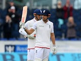England batsman Alastair Cook raises his bat after reaching 10,000 Test runs against Sri Lanka on May 30, 2016