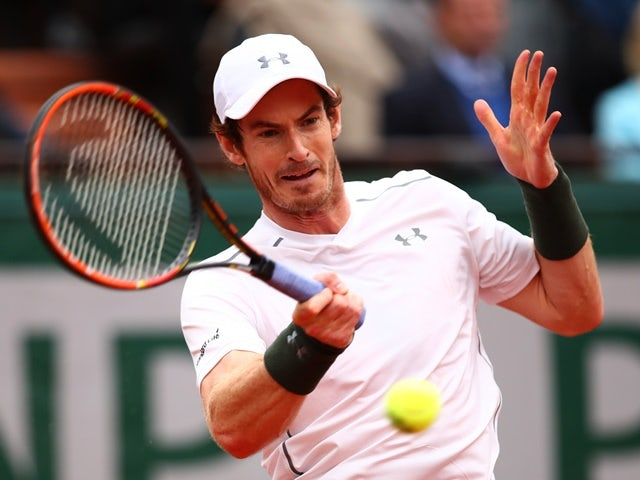 Andy Murray of Great Britain hits a forehand against Stanislas Wawrinka at Roland Garros on June 3, 2016
