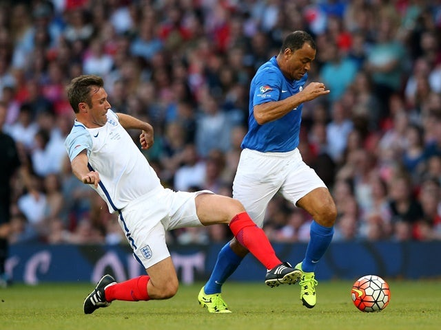 Cafu of Rest of the World beats Jonathan Wilkes of England during the Soccer Aid 2016 match in aid of UNICEF at Old Trafford on June 5, 2016