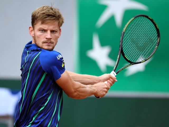David Goffin returns the ball to Ernests Gulbis at the French Open on June 1, 2016