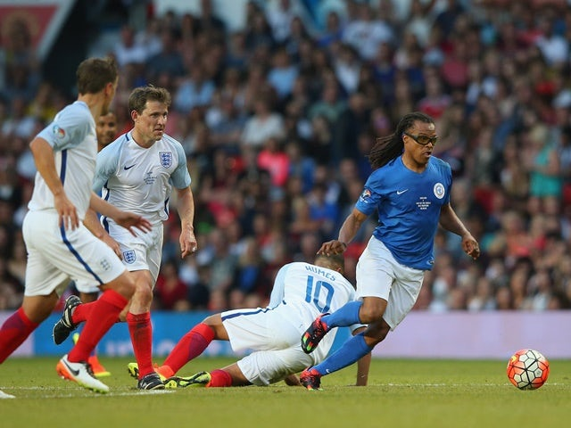 Edgar Davids of Rest of the World beats Marvin Humes of England during the Soccer Aid 2016 match in aid of UNICEF at Old Trafford on June 5, 2016