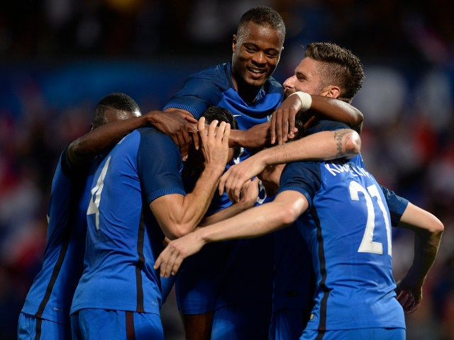 Laurent Koscielny of France (R) celebrates his team's third goal with teammates during the International Friendly between France and Scotland on June 4, 2016 in Metz, France