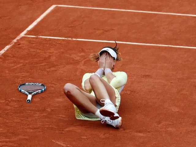 Garbine Muguruza falls to the ground after winning the French Open on June 4, 2016