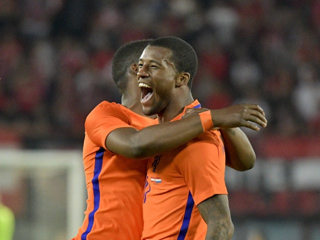 Netherlands' Georginio Wijnaldum celebtrates with a teammate after scoring the 2:0 lead during the EURO 2016 friendly football match Austria vs Netherlands at Ernst Happel stadium in Vienna, on June 4, 2016