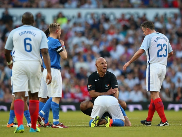 Referee Howard Webb looks to Jamie Carragher of England after a tackle on Shayne Ward of Rest of the World during the Soccer Aid 2016 match in aid of UNICEF at Old Trafford on June 5, 2016