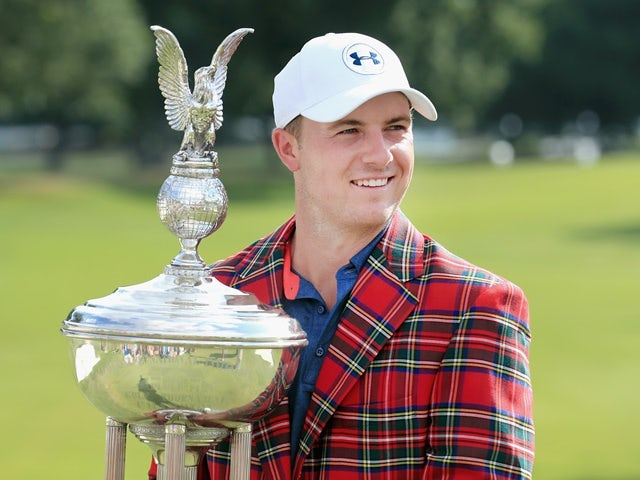 Jordan Spieth poses with the trophy after winning the Dean & Deluca Invitational on May 29, 2016