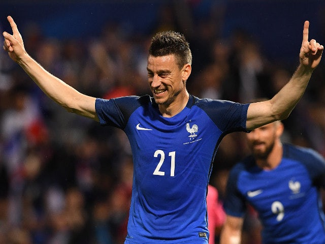 France's defender Laurent Koscielny celebrates his goal during the friendly football match France vs Scotland at the St Symphorien Stadium in Metz, eastern France, on June 4, 2016