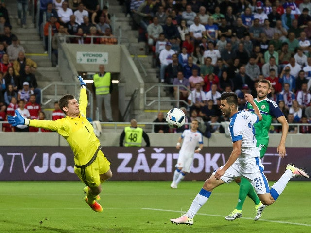 Norhern Ireland's goalkeeper Michael McGovern (L) and Slovakia's Michal Duris and Northern Ireland's Gareth McAuley vie for a ball during the a UEFA EURO 2016 friendly football match between Slovakia and Northern Ireland in Trnava, on June 4, 2016