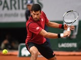 Novak Djokovic hits a backhand in the quarter-final against Tomas Berdych at the French Open on June 2, 2016