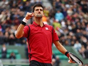 Novak Djokovic safely through in Paris