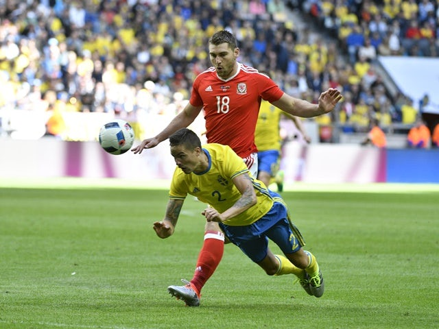 Mikael Lustig of Sweden and Sam Vokes of Wales during the international friendly on June 5, 2016