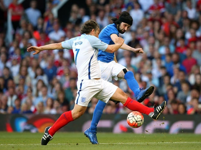 Sergio Pizzorno shoots past John Bishop during the Soccer Aid 2016 match in aid of UNICEF at Old Trafford on June 5, 2016