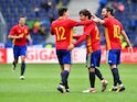Spain's players celebrate after scoring during the international friendly football match against South Korea on June 1, 2016