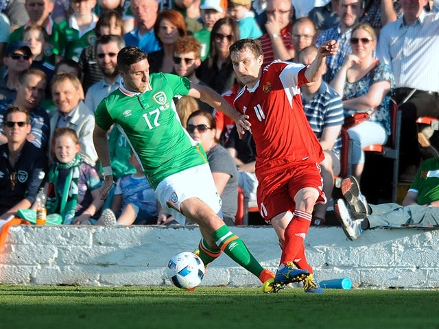 Republic of Ireland's Stephen Ward tries to tackle Belarus's Mikhail Hardzeichuk on May 31, 2016