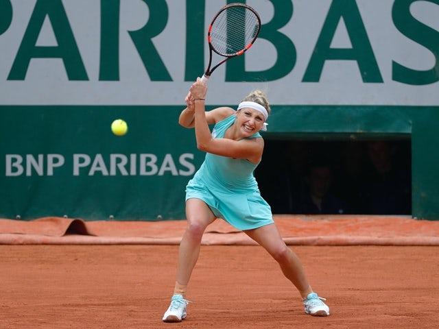 Timea Bacsinszky returns the ball to Venus Williams on June 1, 2016
