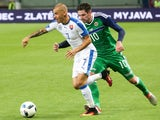 Slovakia's Vladimir Weiss (L) and Northern Ireland's Kyle Lafferty (R) vie for a ball during the a UEFA EURO 2016 friendly football match between Slovakia and Northern Ireland in Trnava, on June 4, 2016