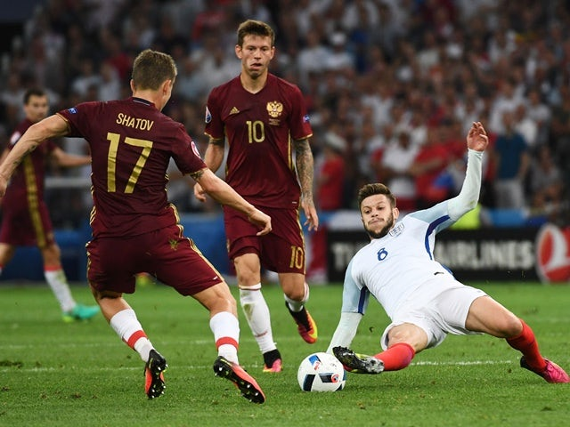Adam Lallana and Oleg Shatov in action during the Euro 2016 Group B game between England and Russia on June 11, 2016