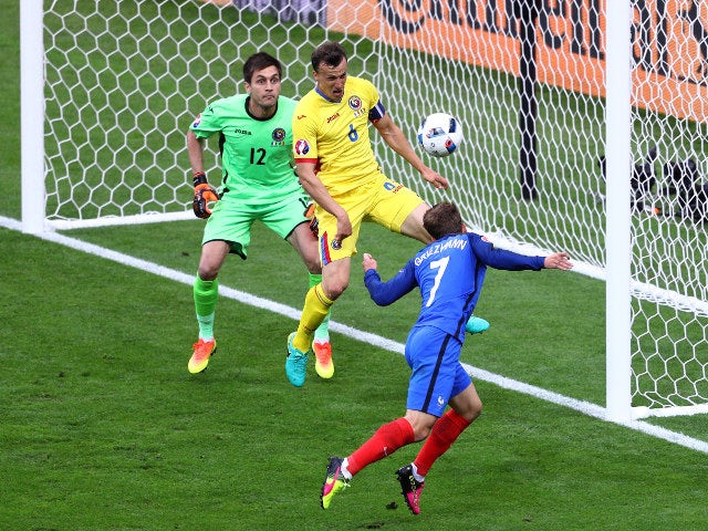 Antoine Griezmann of France heads the ball hitting a post during the UEFA Euro 2016 Group A match between France and Romania at Stade de France on June 10, 2016 in Paris, France