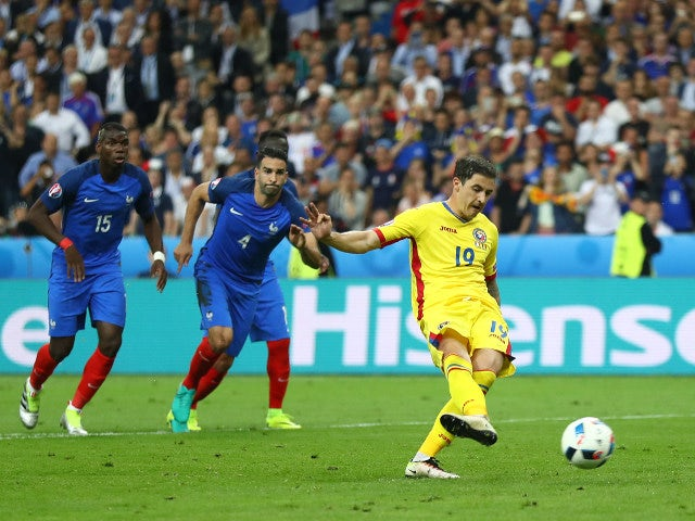 Bogdan Stancu of Romania converts the penalty to score his team's first goal during the UEFA Euro 2016 Group A match between France and Romania at Stade de France on June 10, 2016 in Paris, Franc