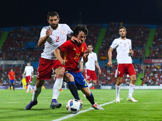 David Silva of Spain competes for the ball with Navalovskii of Georgia during an international friendly on June 7, 2016