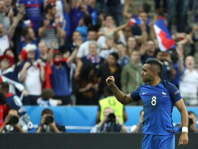 France's forward Dimitri Payet celebrates scoring France's second goal during the Euro 2016 group A football match between France and Romania at Stade de France, in Saint-Denis, north of Paris, on June 10, 2016