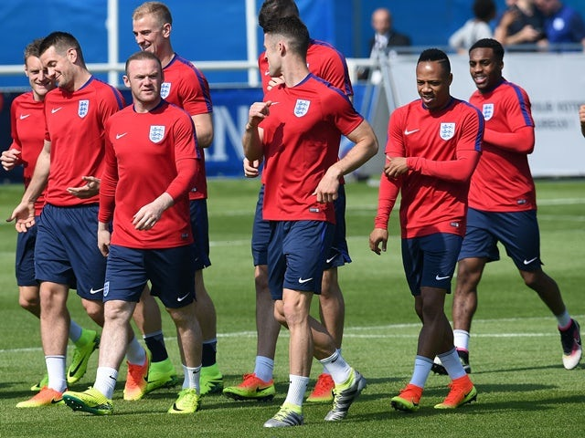 England's players run during a training session at their training ground in Chantilly, on June 7, 2016