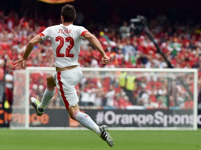 Switzerland's Fabian Schaer celebrates after scoring the opening goal during the Euro 2016 Group A match against Albania on June 11, 2016