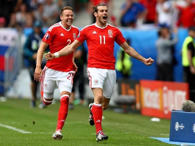 Gareth Bale celebrates scoring Wales s first goal against Slovakia at Euro  2016 on June 11 015a12e76e5a9