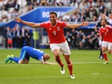 Hal Robson-Kanu of Wales celebrates scoring their second goal against Slovakia at Stade Matmut Atlantique on June 11, 2016