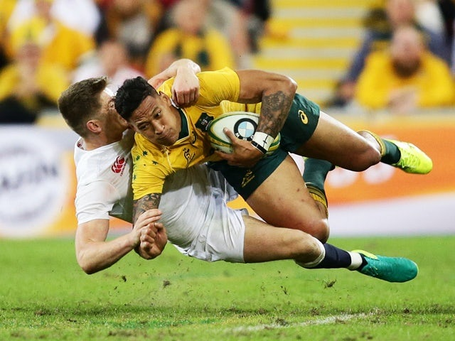 Israel Folau of Australia is tackled by Owen Farrell of England during the international Test match on June 11, 2016